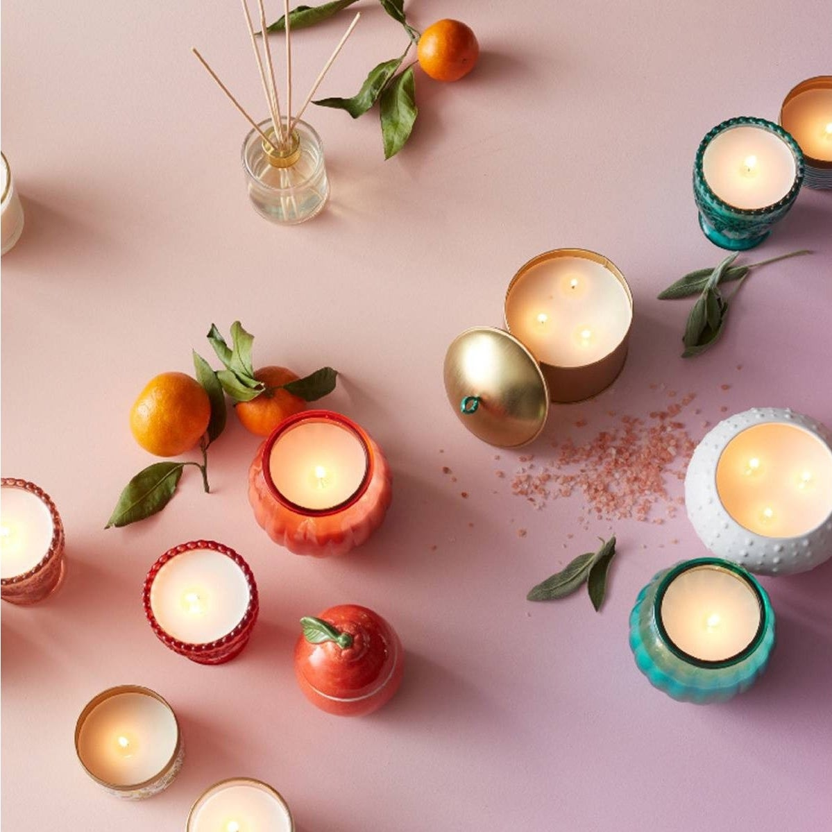 Opalhouse lidded candles with fruit and other jars on a light pink background