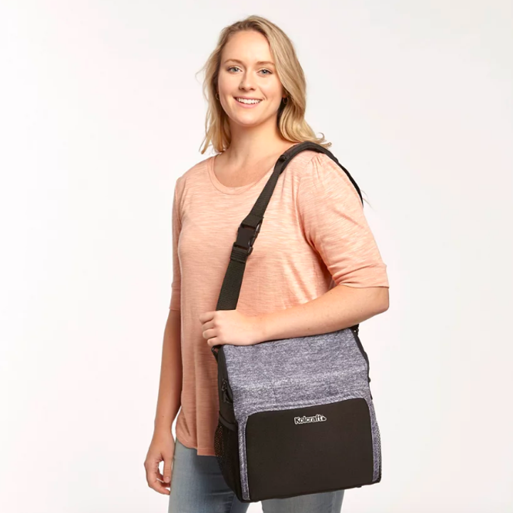 Person carrying diaper bag when not in use as seat. It has a side strap.