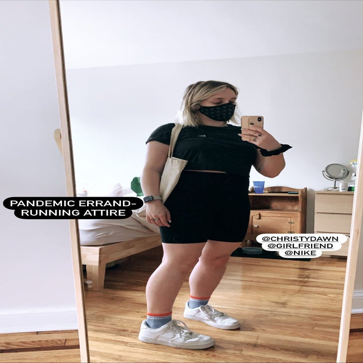 A BuzzFeed editor in a black face mask