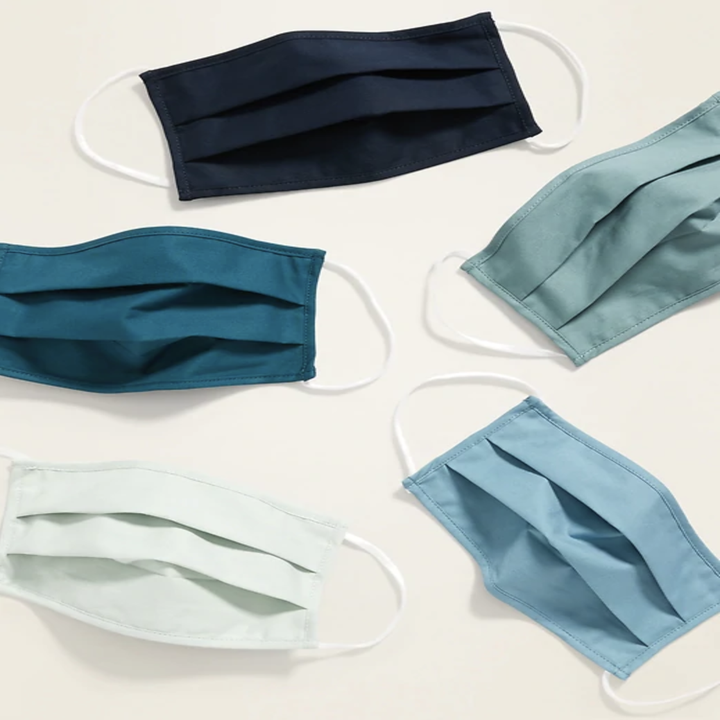 Five face masks in blue tones