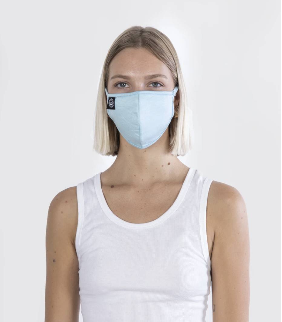 Model in a baby blue face mask