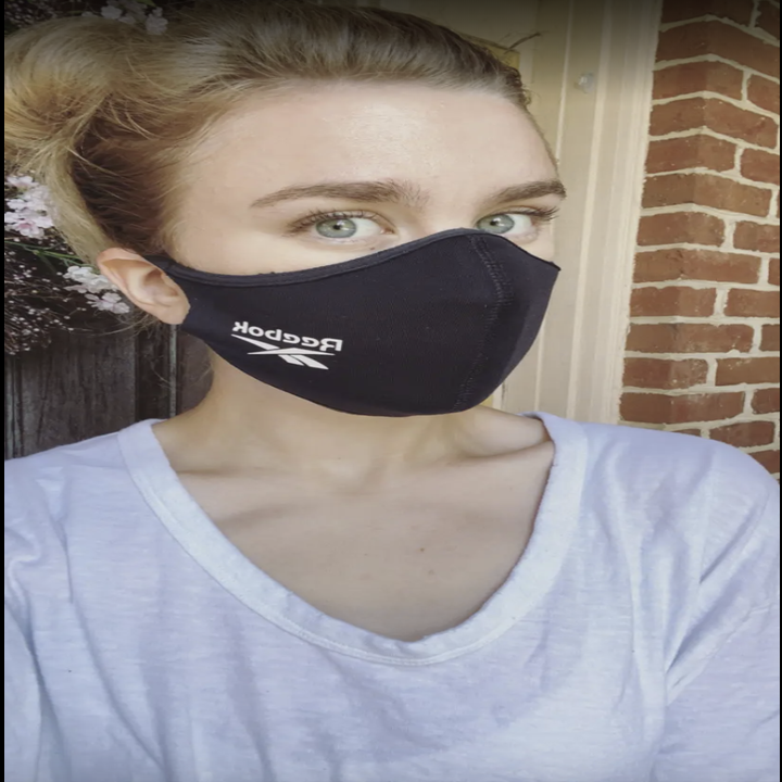 BuzzFeed editor in black face mask with reebok logo