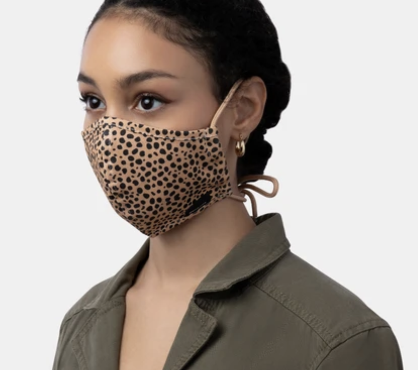 Model in a leopard print face mask