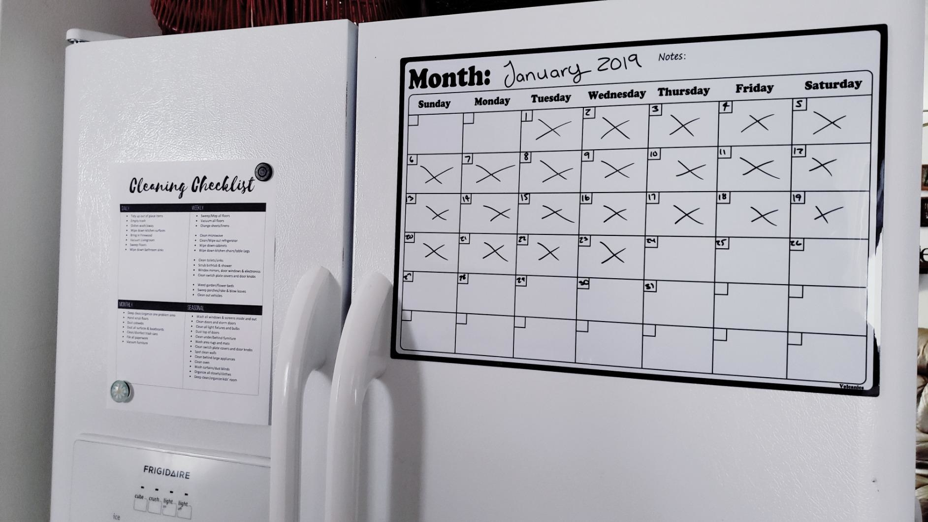 reviewer image of the dry erase calendar on a customer's fridge