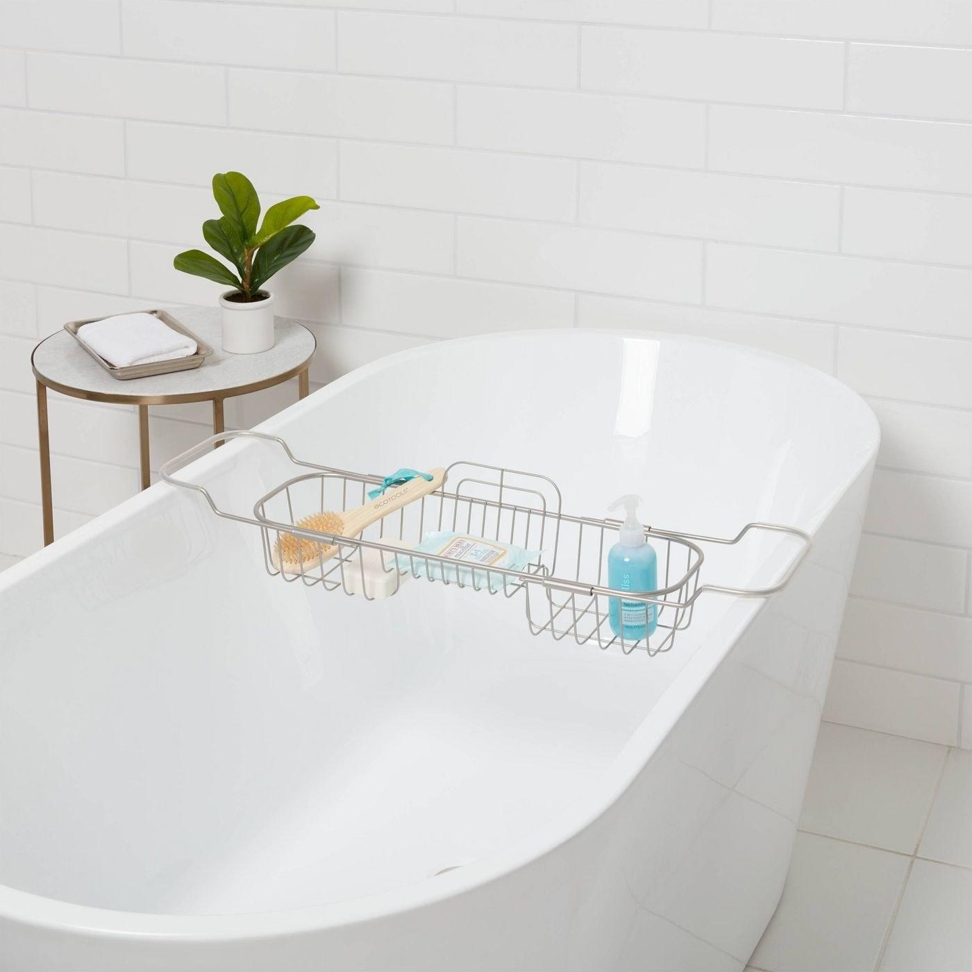 Satin bathtub caddy with wipes, soap and a tan bath brush
