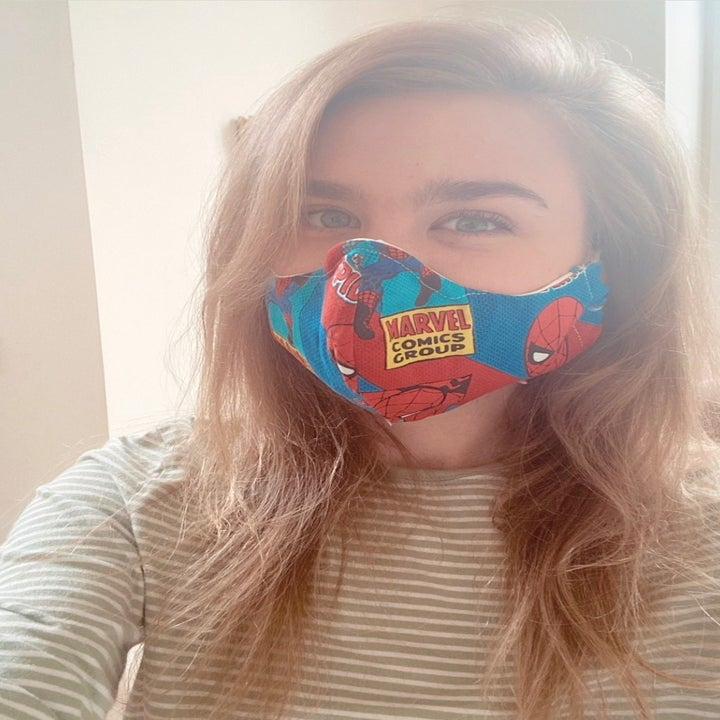 BuzzFeed editor in a Spider-Man face mask