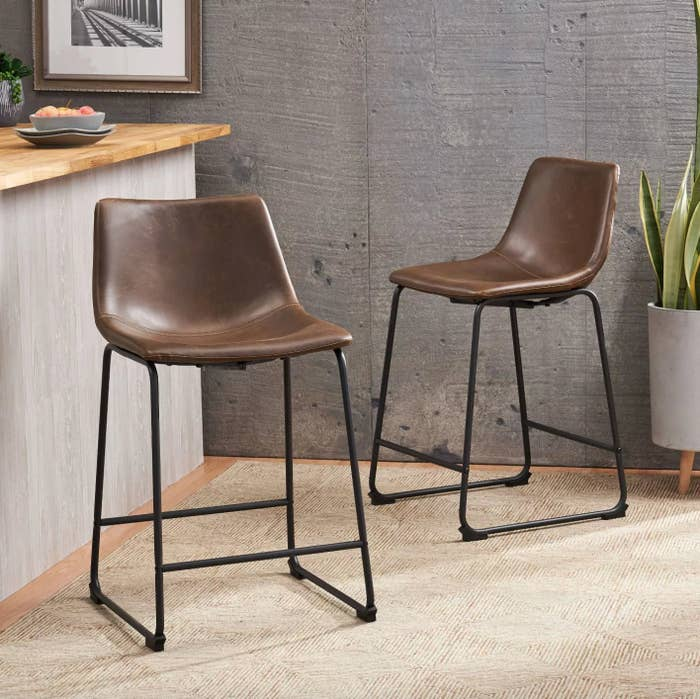The counter height barstools in vintage brown