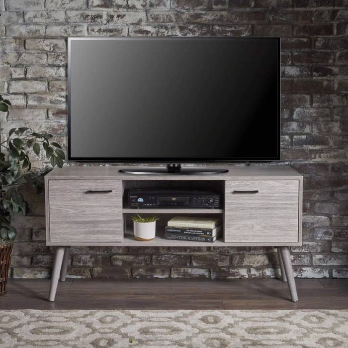 The mid-century modern media console in gray