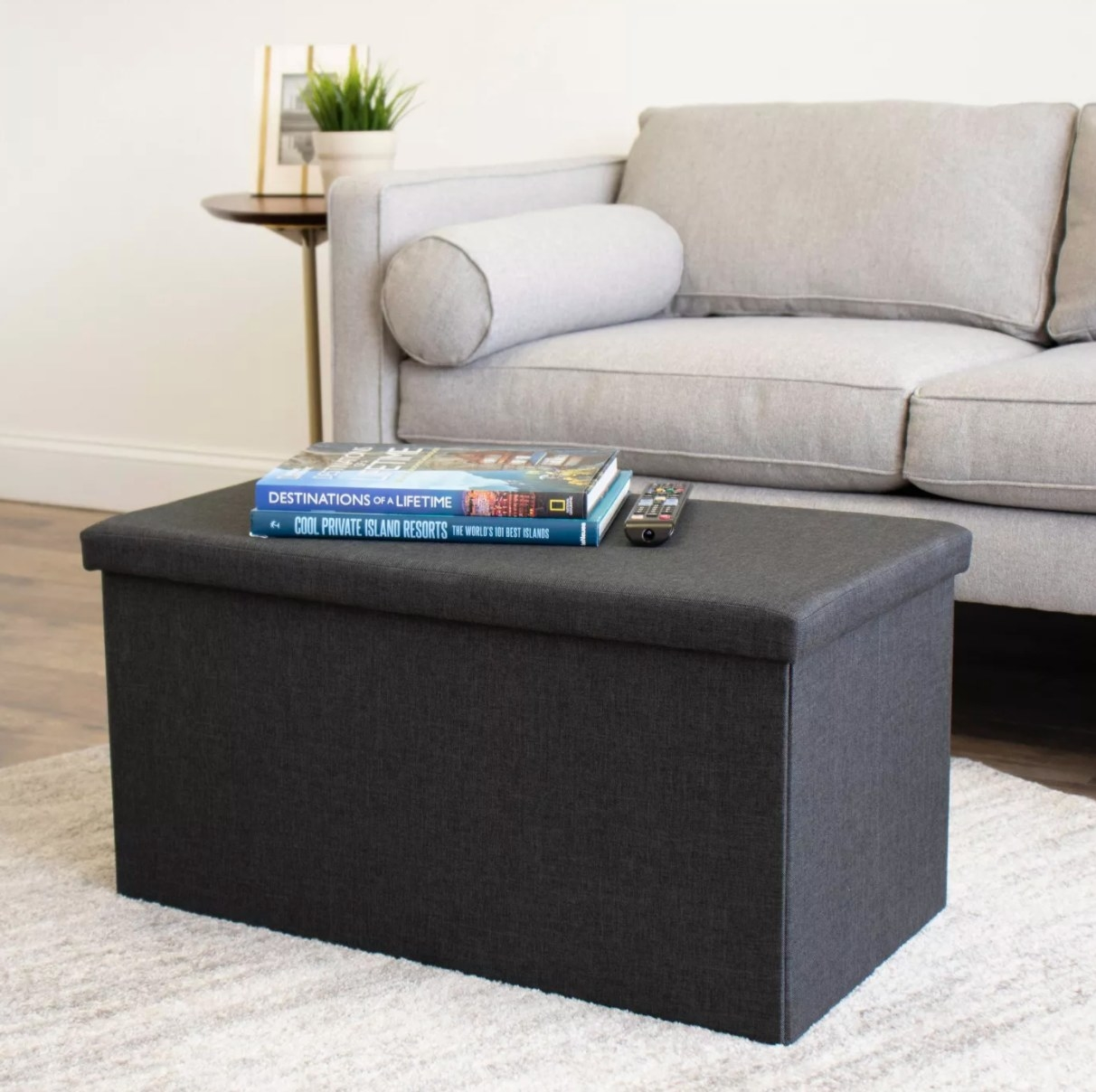 The heathered storage ottoman in charcoal gray