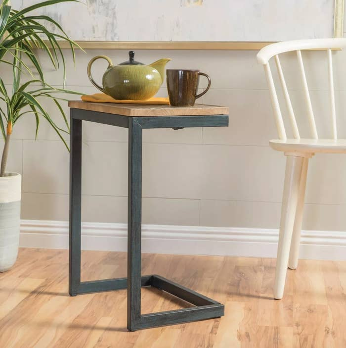 The firwood side tablein wood and steel
