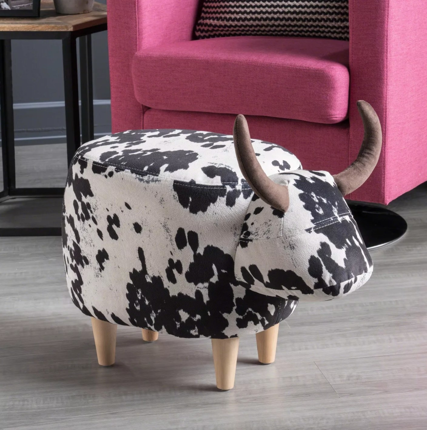 The cow ottoman in black and white