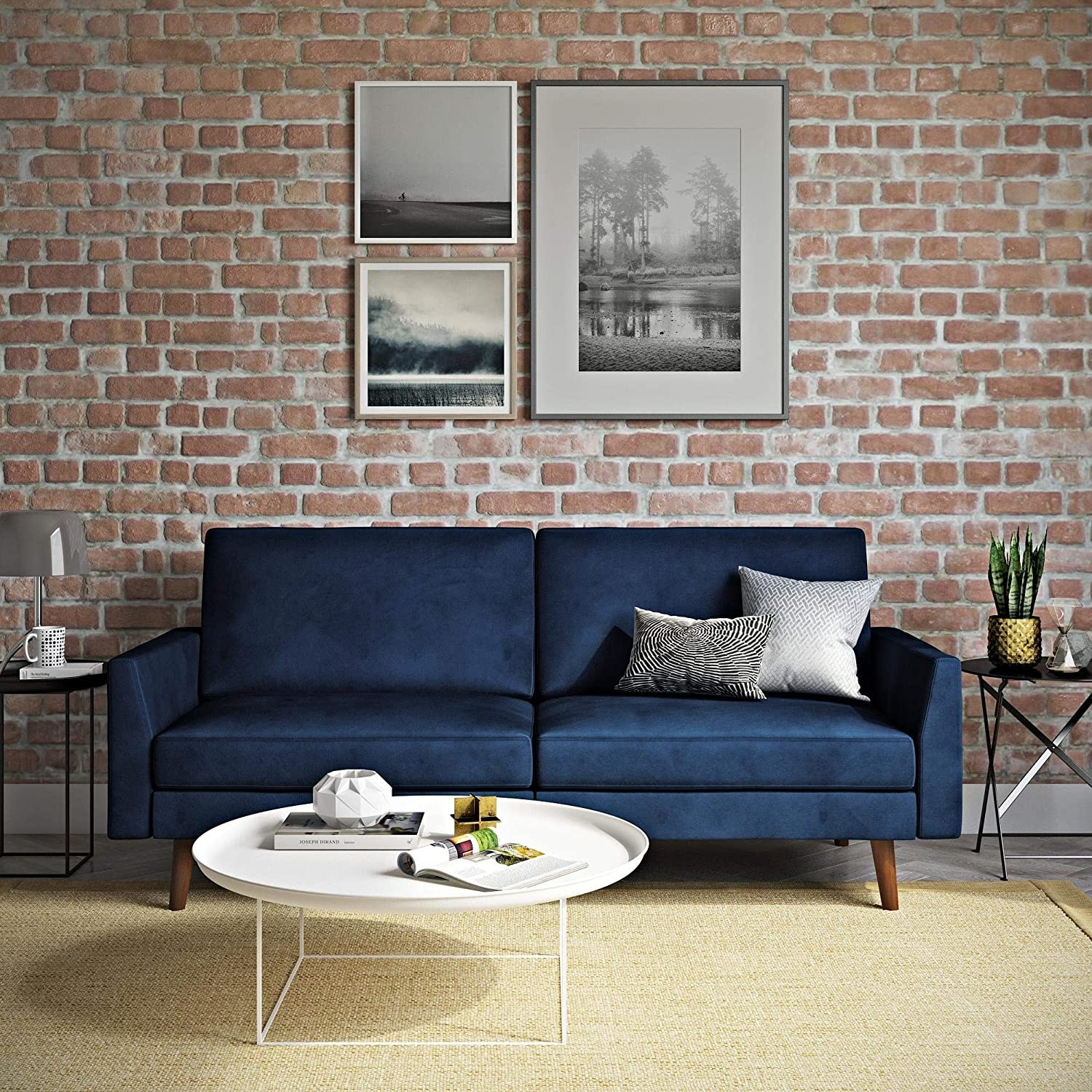 navy velvet futon that looks like a mid-century couch with wood legs