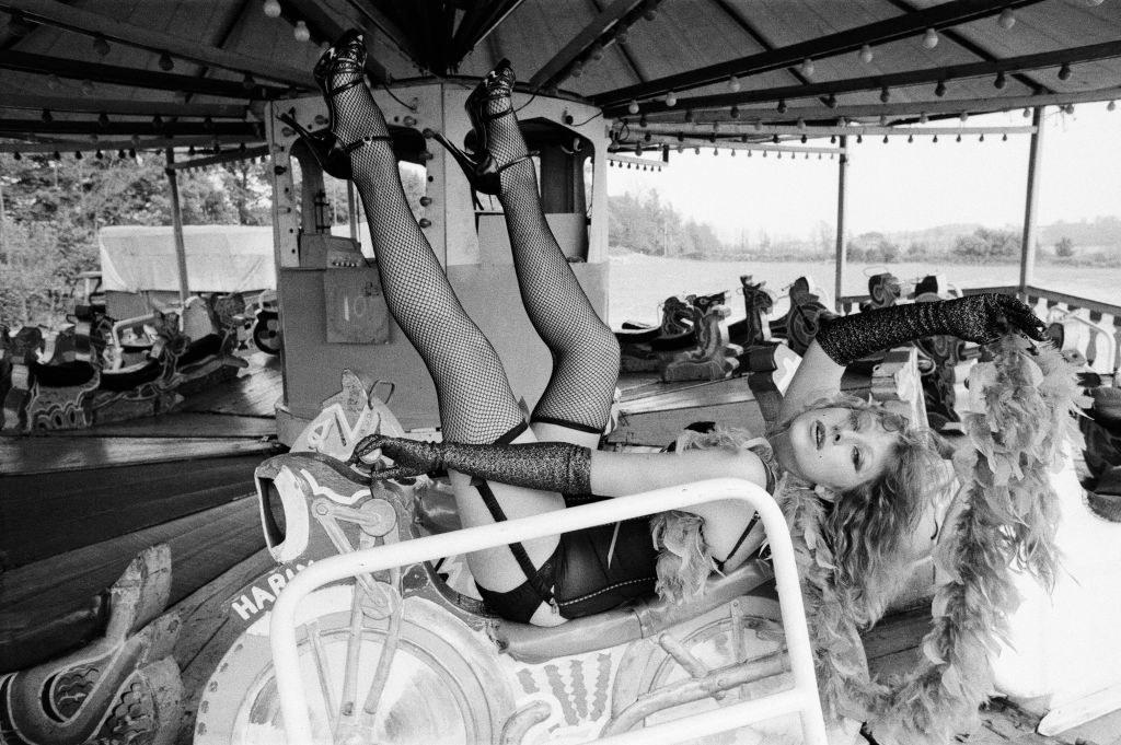 Helen in lingerie on an amusement park ride