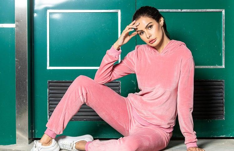 Model wearing pink tracksuit