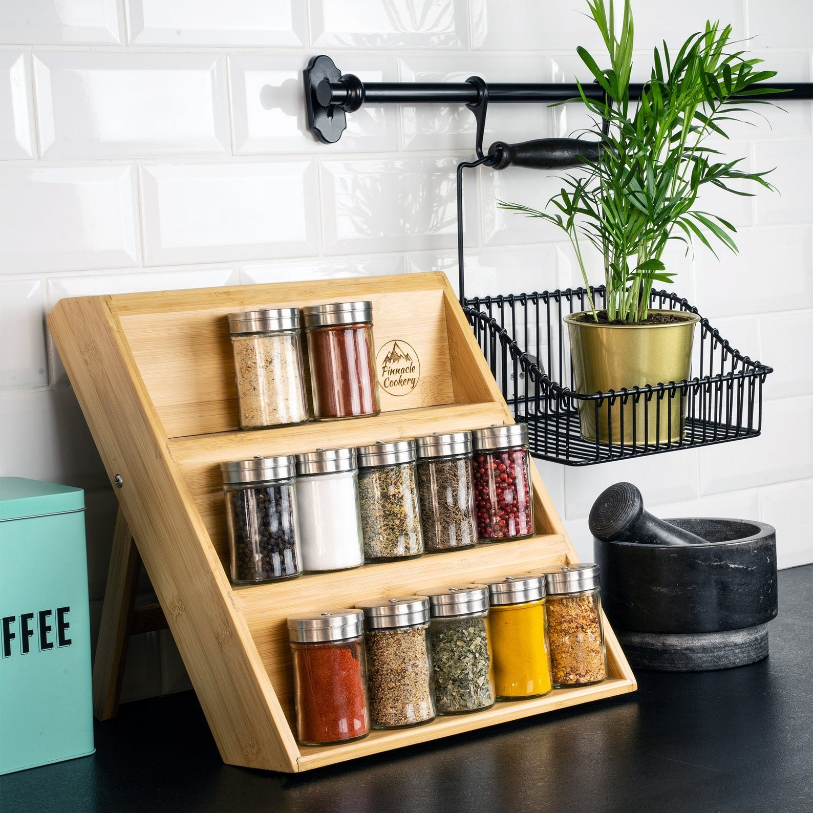 the three tier Bamboo Spice Rack on a kitchen counter with spices on each tier
