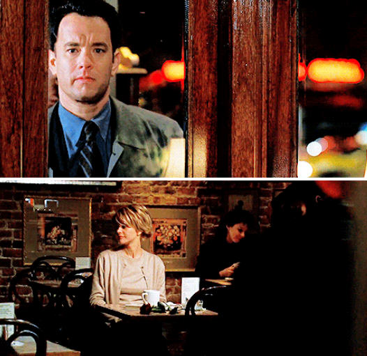 Joe looking at Kathleen sitting by herself in the café through the window