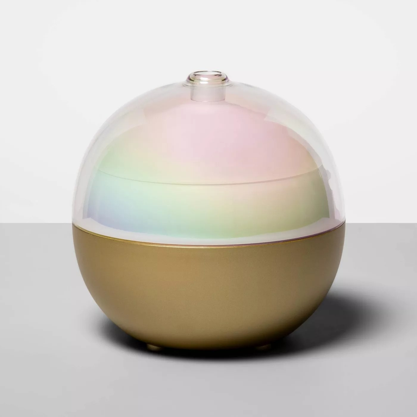 Round gold and LED light essential oil diffuser
