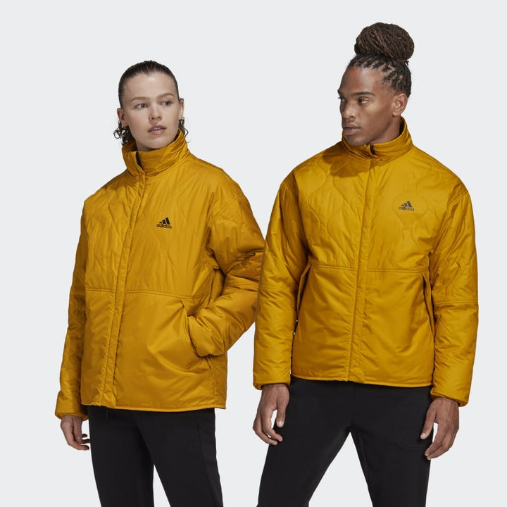 Two models wearing the yellow jacket with the fleece side in