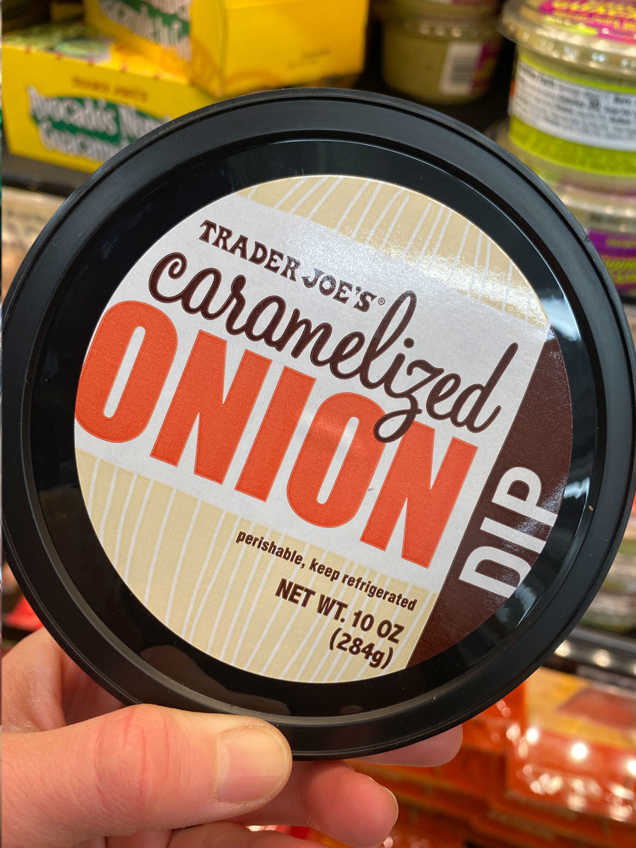 A container of Trader Joe's Caramelized Onion Dip.