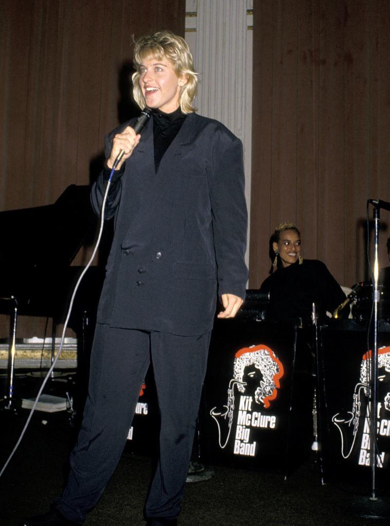 Ellen in a very large suit