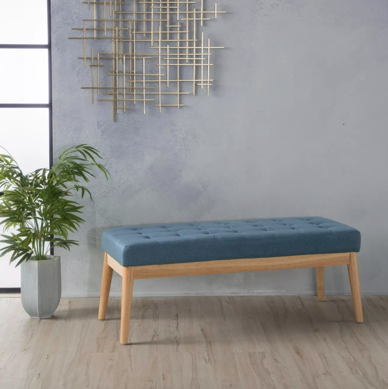 The upholstered bench in blue