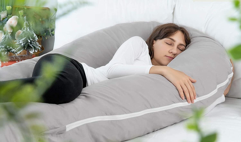 woman sleeping between the pillow
