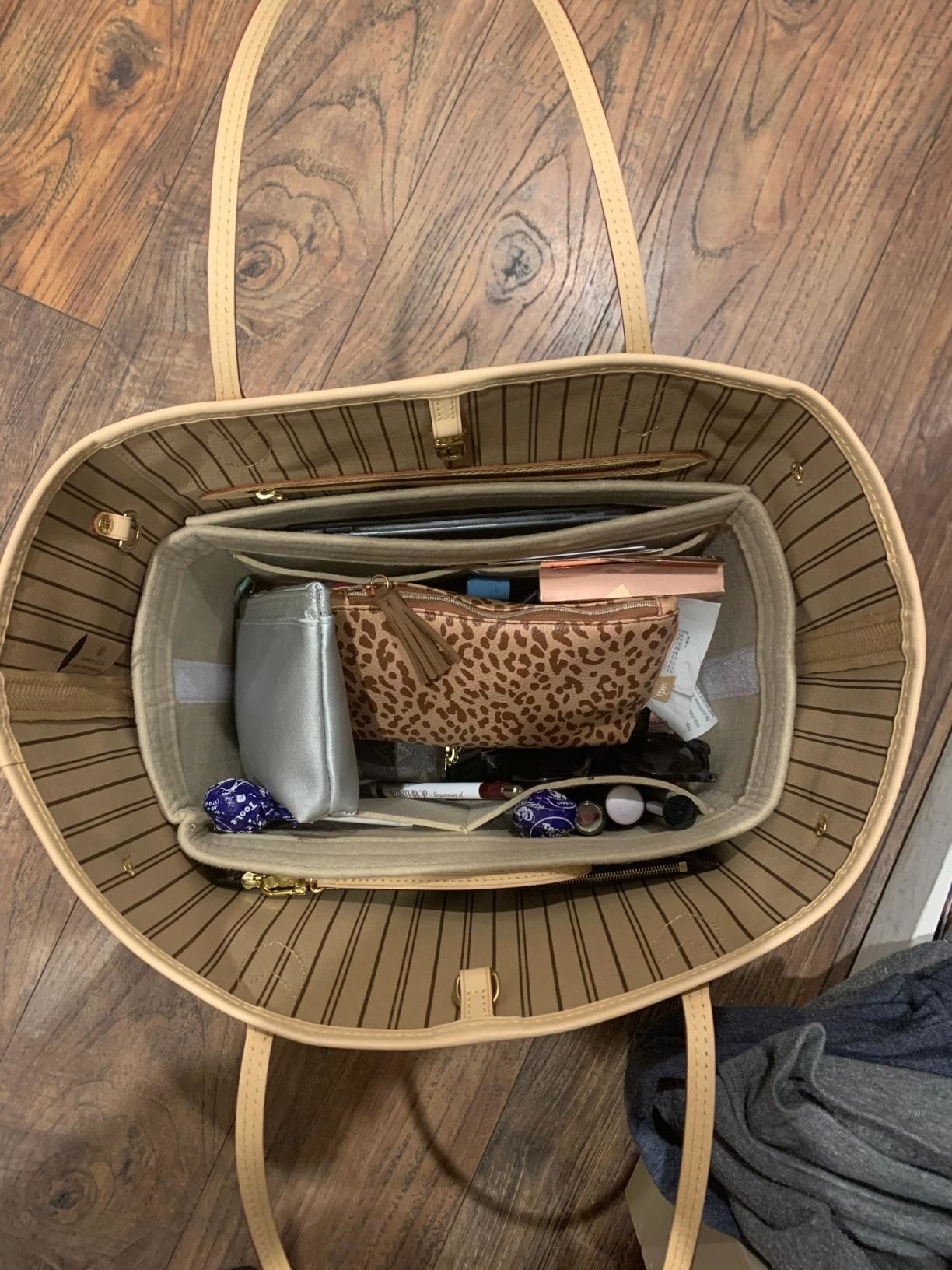 reviewer image of the purse organizer insert inside of a customer's tote bag