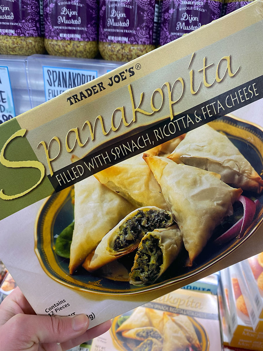 A box of frozen Spanakopita with Spinach, Ricotta, and Feta Cheese.