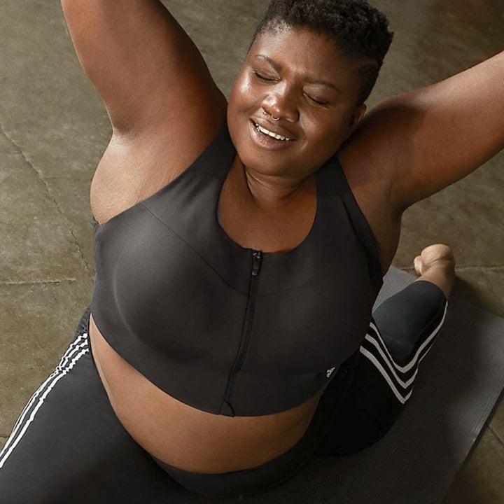A model wearing the bra while doing a split