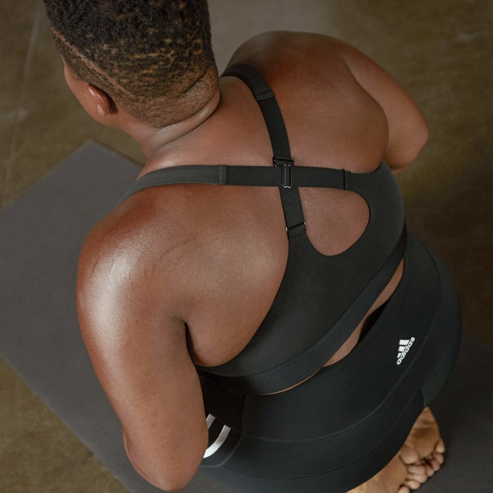 A model showing the racerback features of the bra