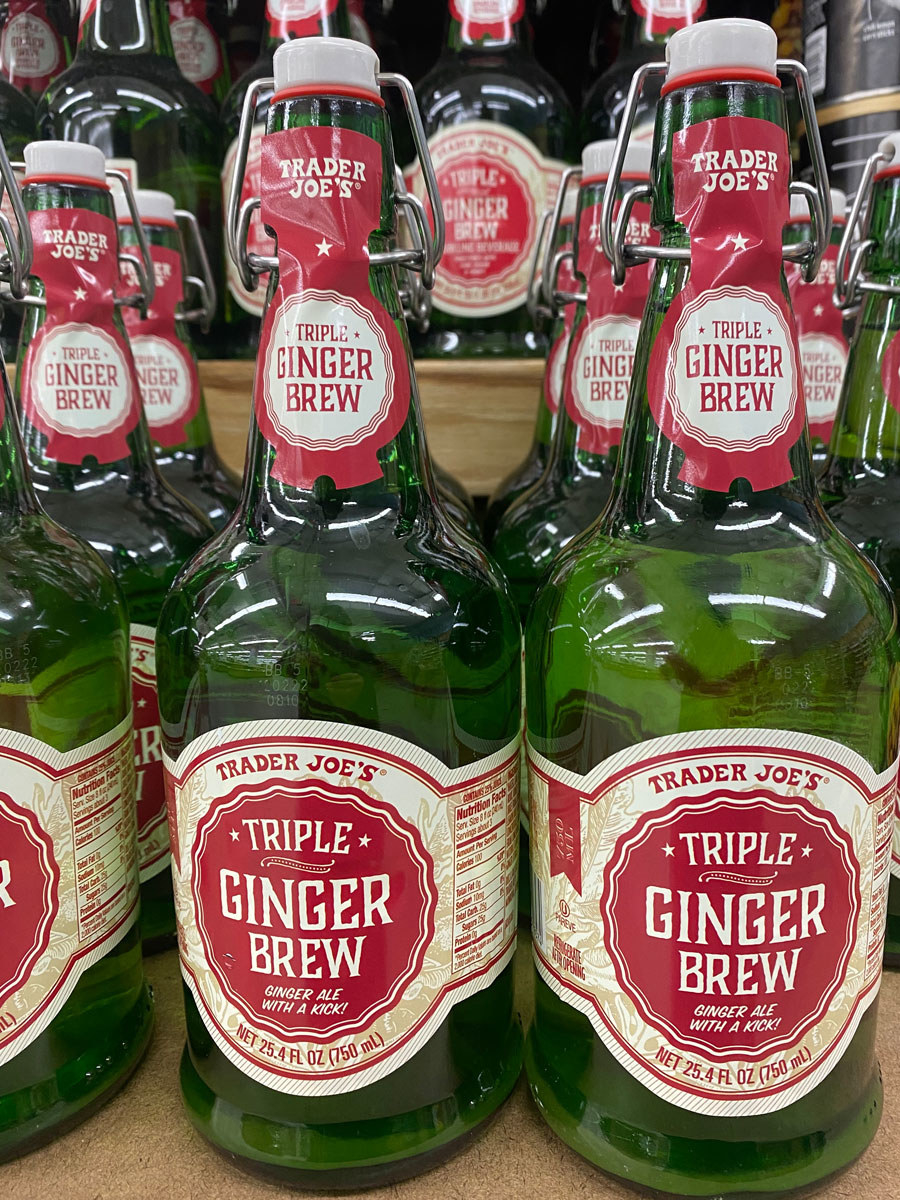 Several glass bottles of triple ginger brew from Trader Joe's.