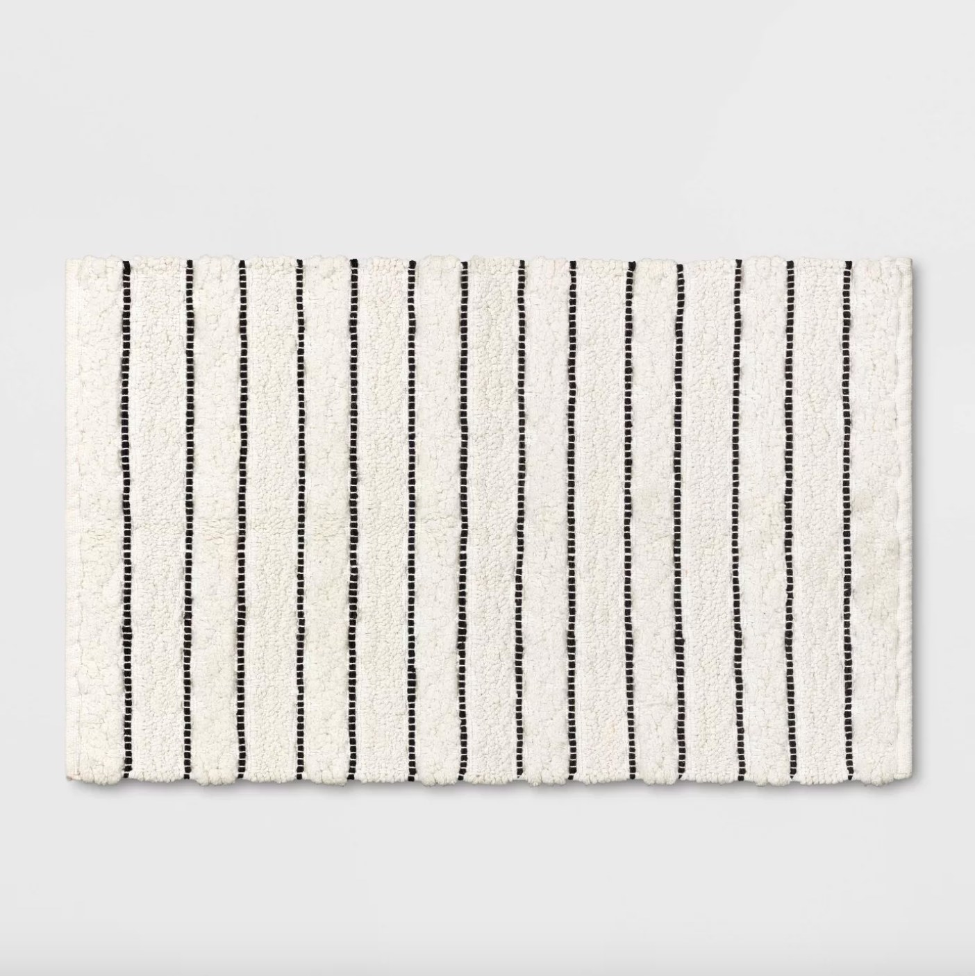 The striped bath mat in white and black