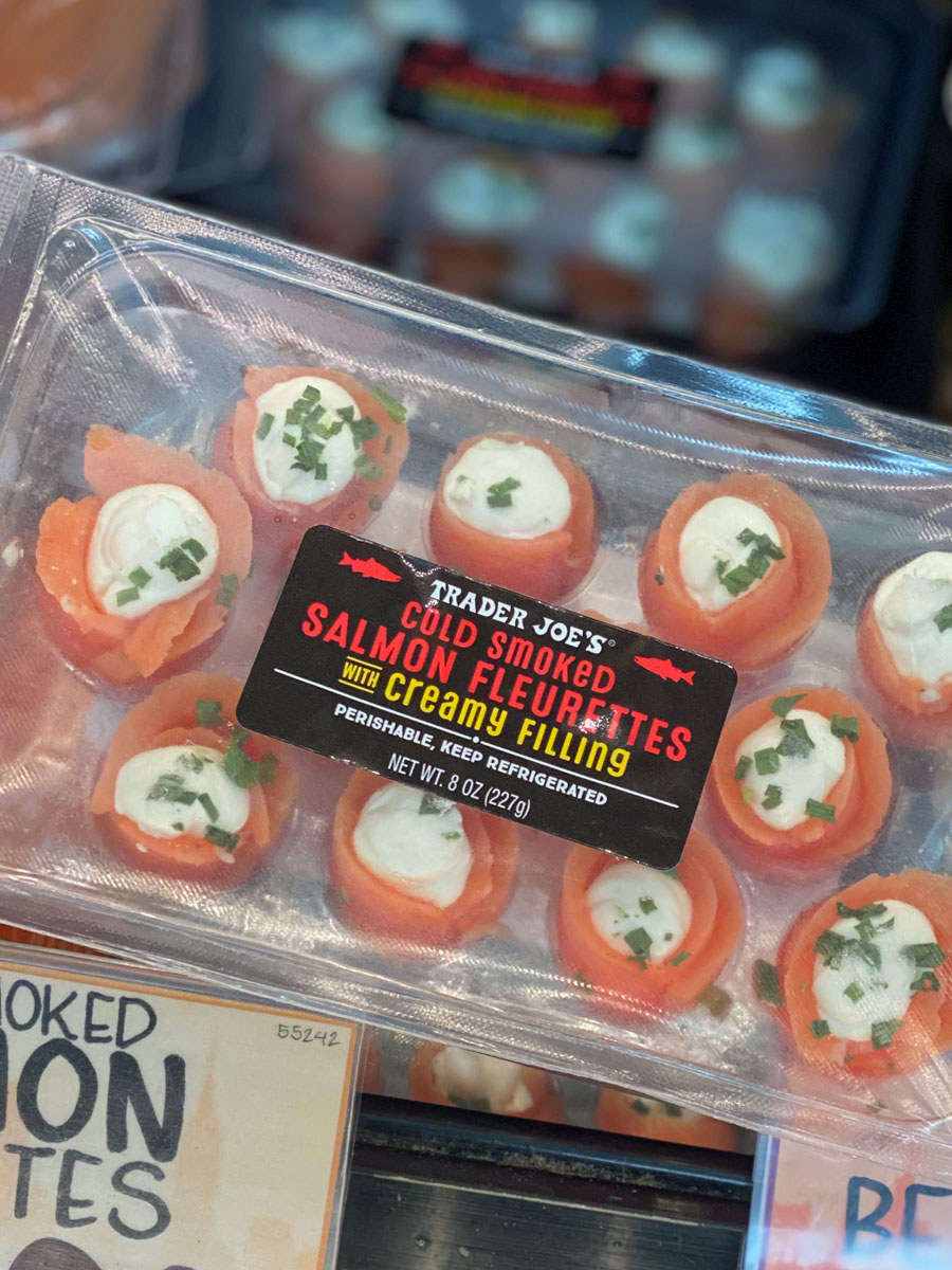 A box of smoked salmon and cream cheese roll-ups.
