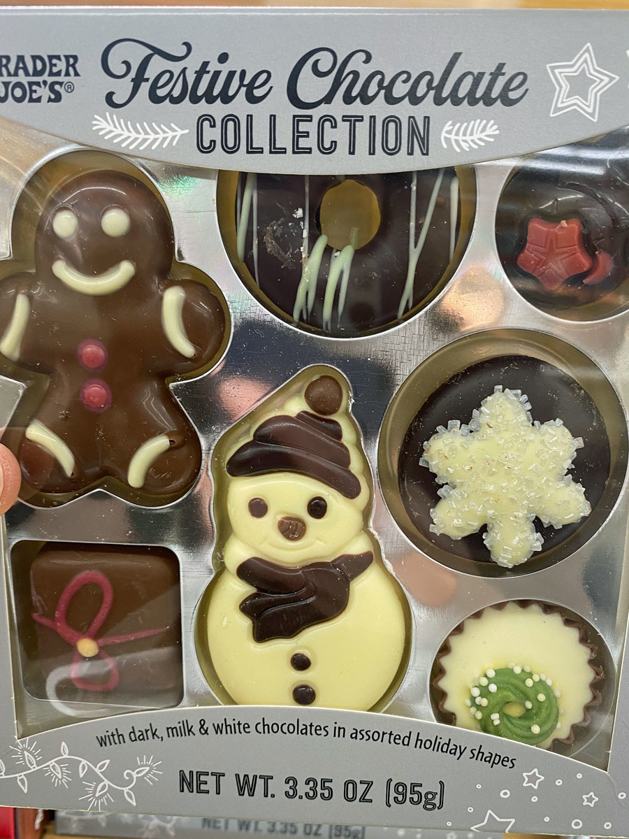 An assortment of holiday themed dark, milk, and white chocolates.