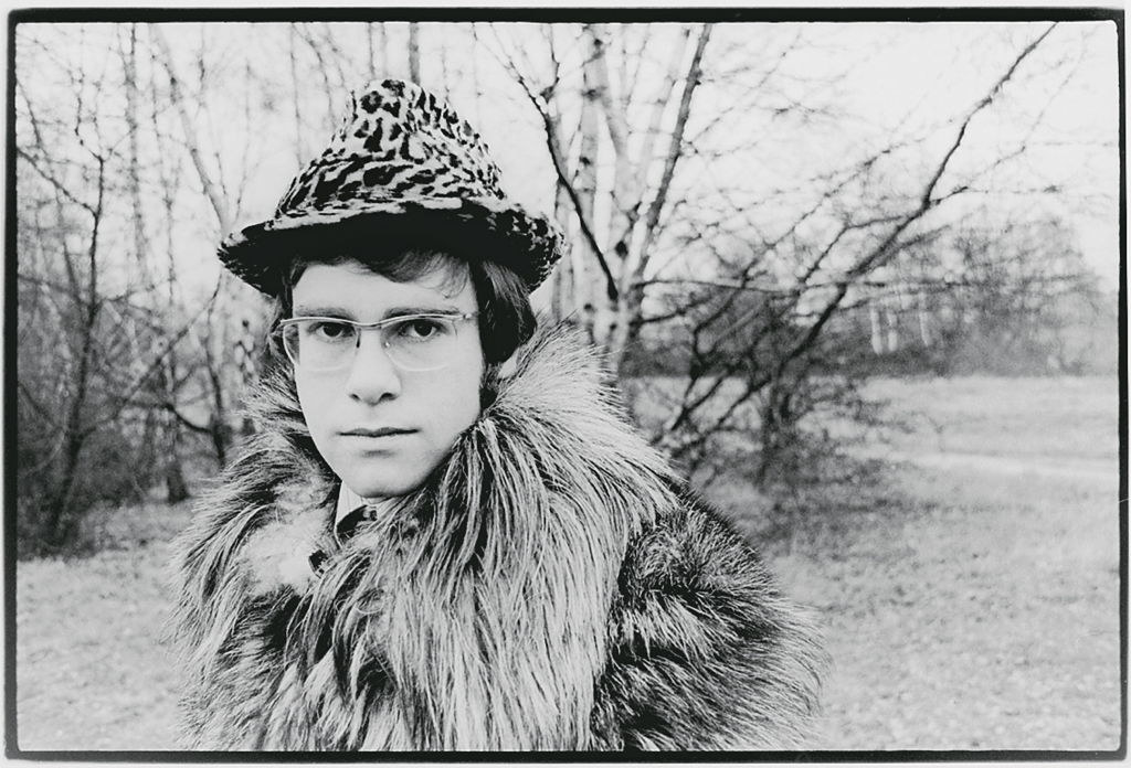 Elton in a furry coat and leopard print hat