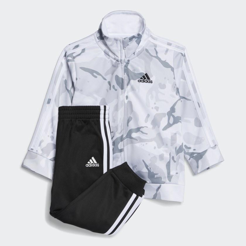 The gray camo jacket and black sweatpants