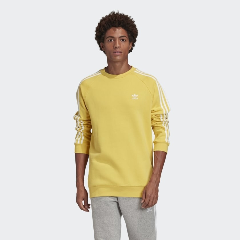 A model wearing the sweater in yellow