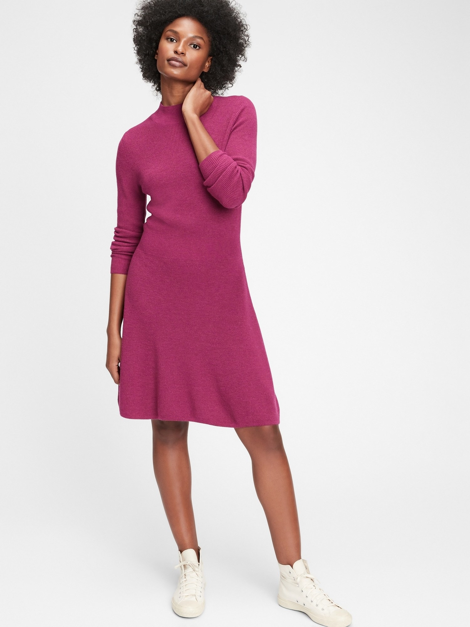 Model wearing the knee-length long sleeved dress in pink