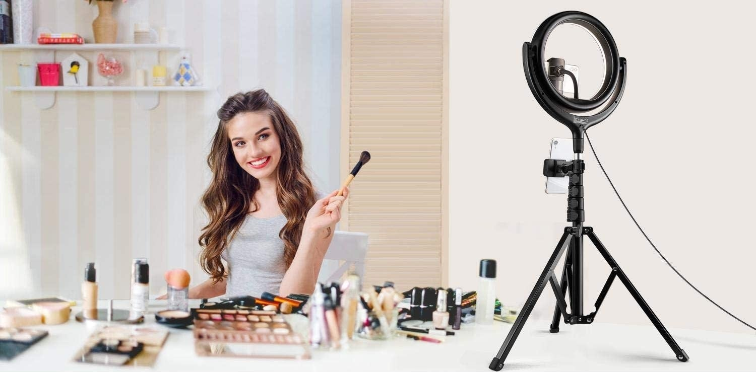 person using the ring light to film a makeup tutorial