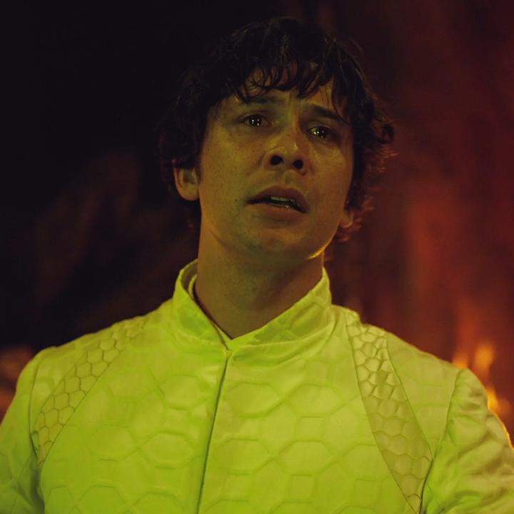 A close up of Bellamy with a sad expression on his face