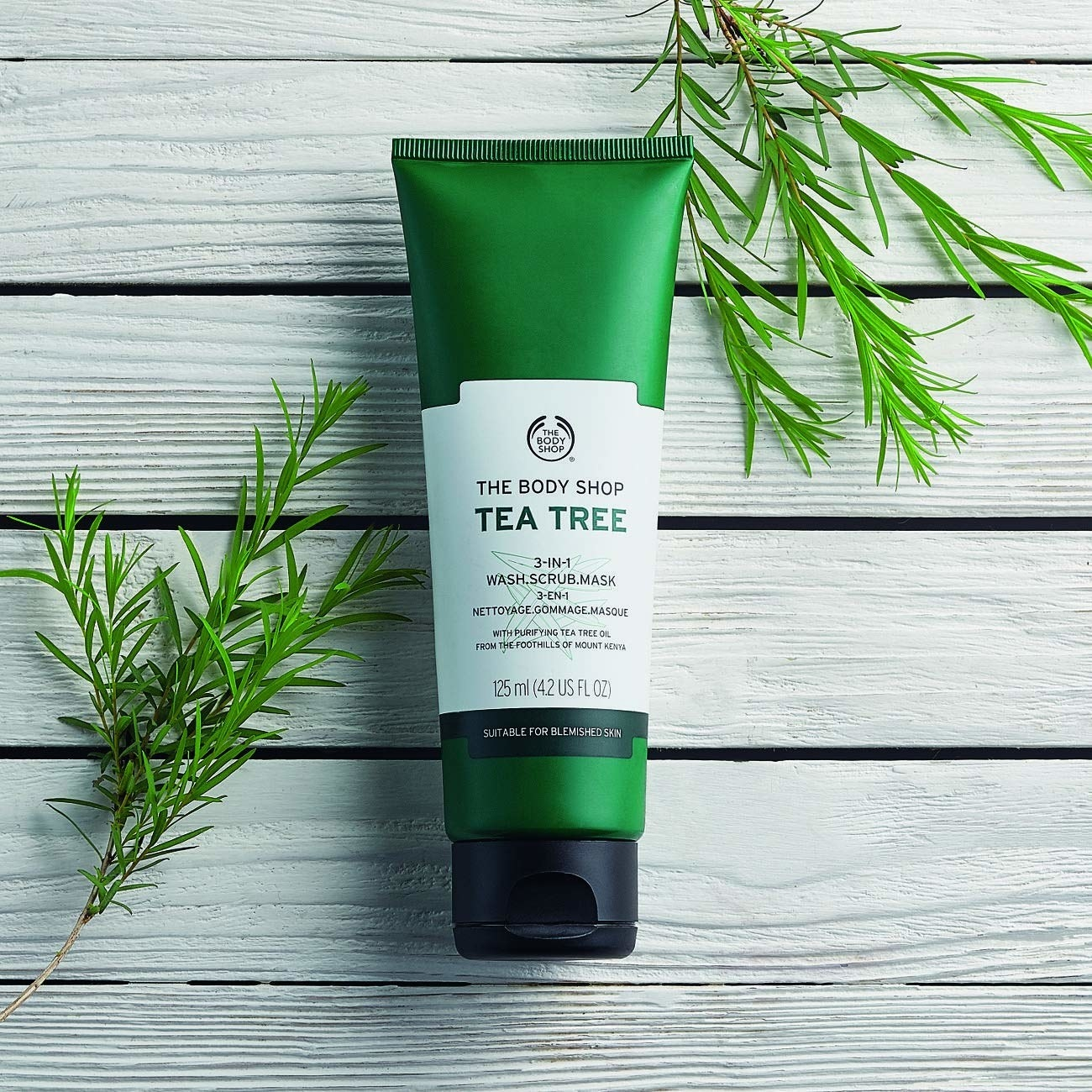 The Body Shop's 3-in-1 wash, scrub, and face mask in a green container
