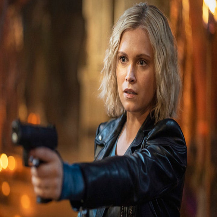 Clarke holding out and pointing a gun