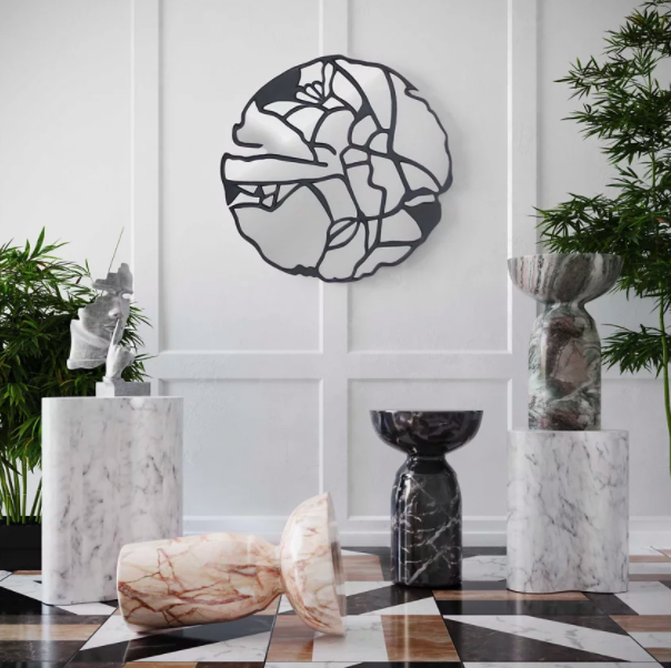 circular wall mirror with abstract black lines running through it