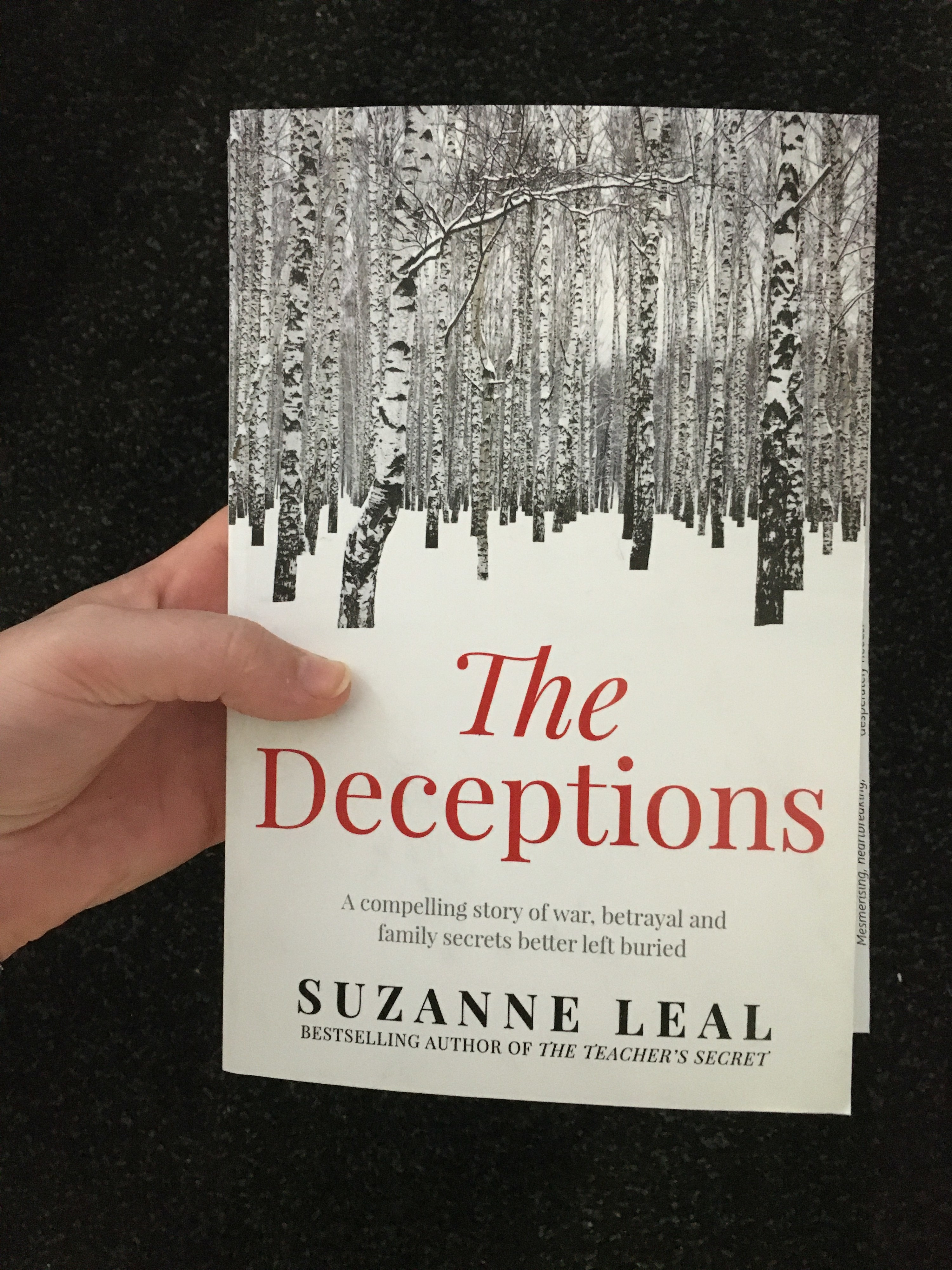 """Front cover of a book showing thin trees in snow with the title down the bottom """"The Deceptions"""""""