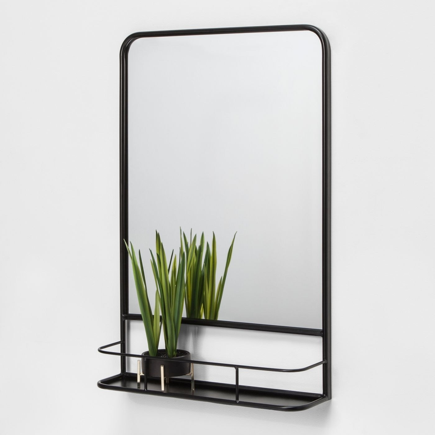 A black rectangle pharmacy mirror