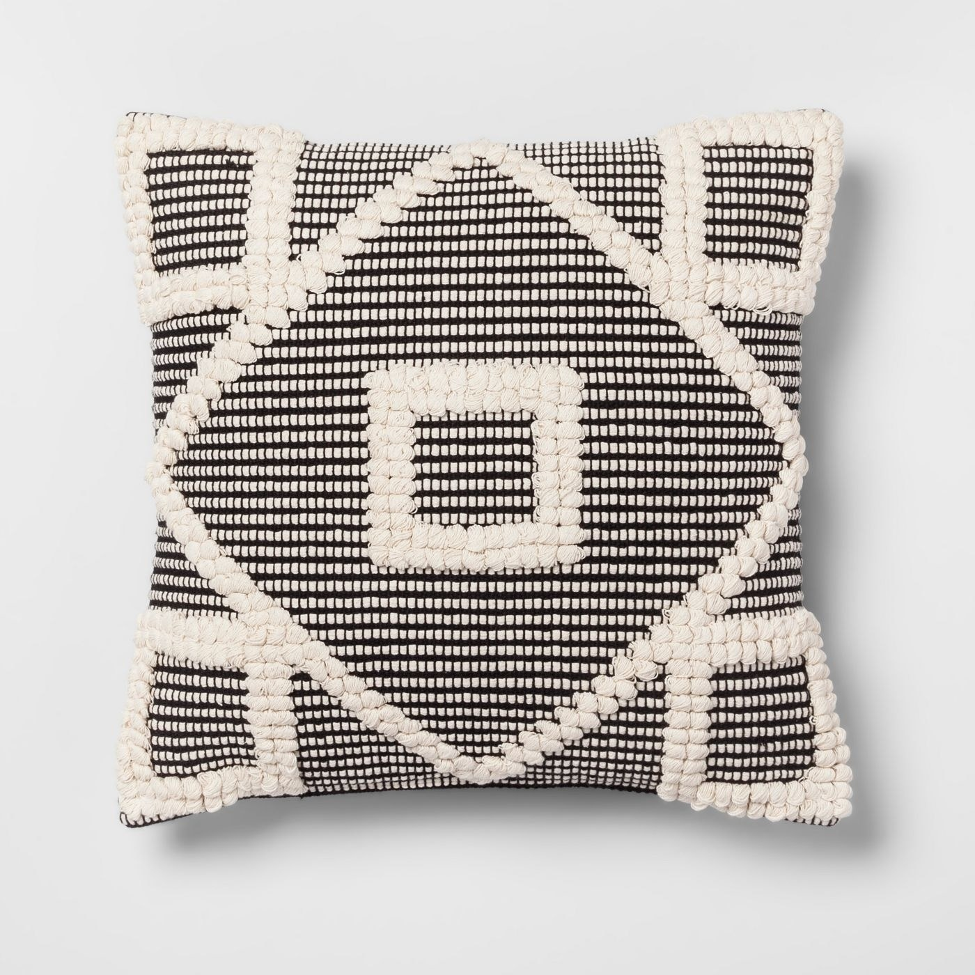 A black and white geometric design tufted throw pillow