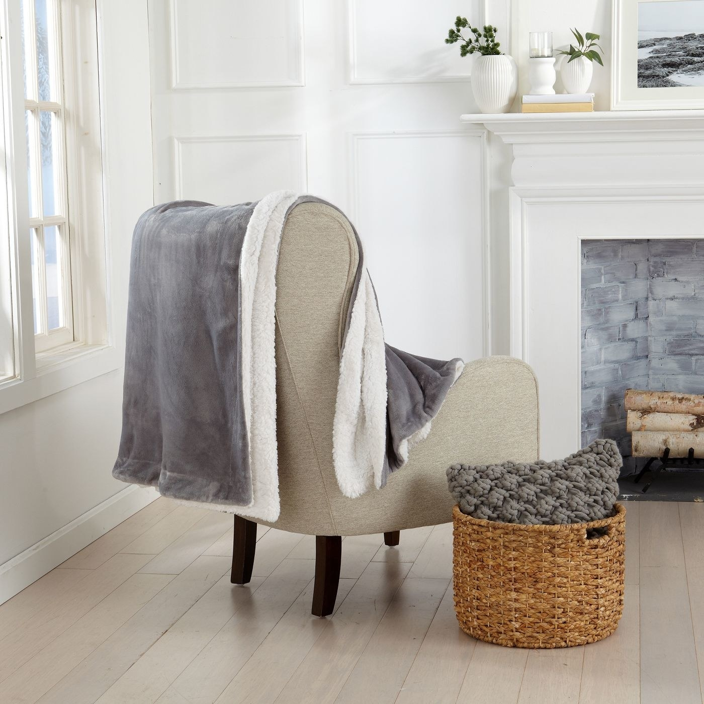 A grey plush sherpa throw blanket