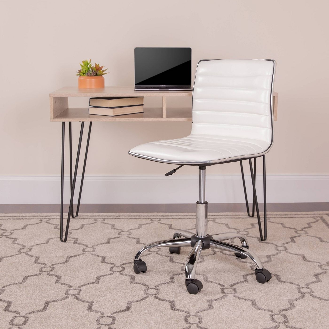 A white armless swivel office chair