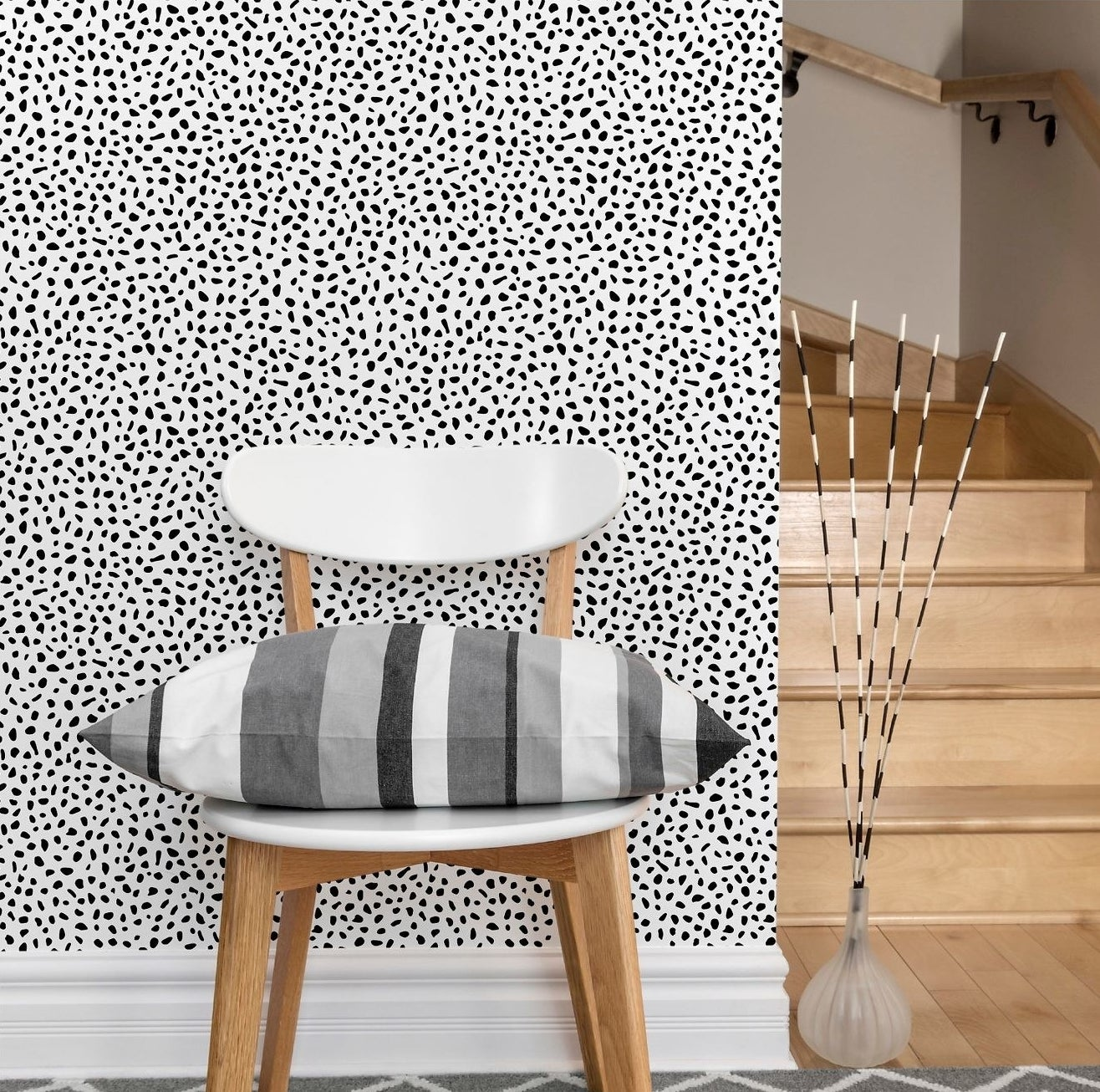A black and white speckled pattern wallpaper