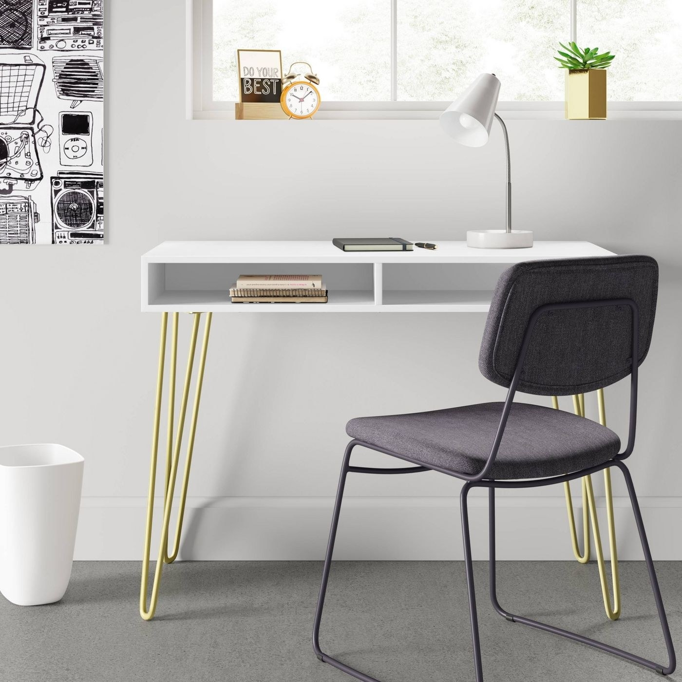 A white writing desk with gold metal hairpin legs